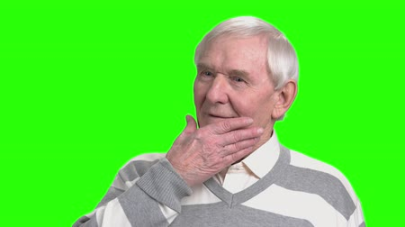 energized : Close up old man massage his chin. Self chin rubbing. Hromakey background. Stock Footage