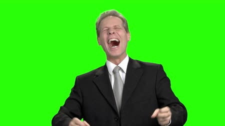 overwrought : Successful happy businessman screaming up. Man in suit head up and put hands up, green hromakey background for keying.