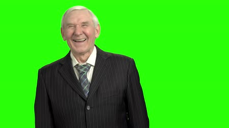ouder : Happy old man in suit laughing hard. Laughing elderly man portrait, green screen hromakey background.