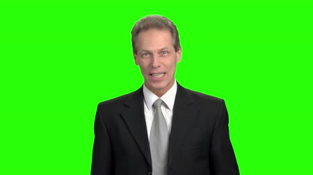 energized : Extremely excited salesman. Happy excited mature salesman sells product on TV, green hromakey. Stock Footage