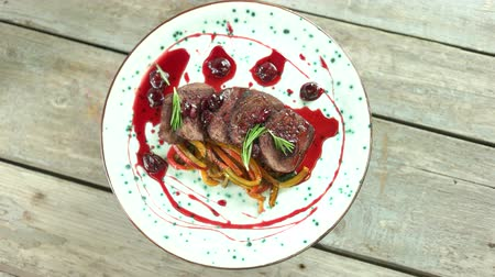 veal recipe : Veal tenderloin top view. Meat with cherry sauce.