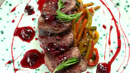 veal recipe : Delicious veal tenderloin. Roasted meat with cherry sauce. Stock Footage