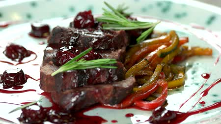 veal recipes : Roasted veal with cherry sauce. Meat dish macro.