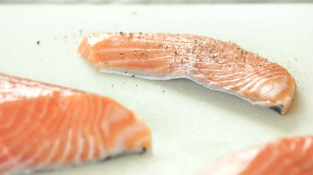 çeşniler : Sliced raw salmon with pepper. Uncooked fish close up.