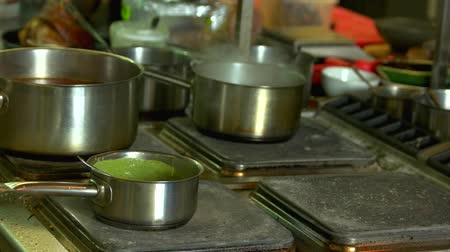 çeşniler : Saucepan with green soup. Vegetable puree preparation.
