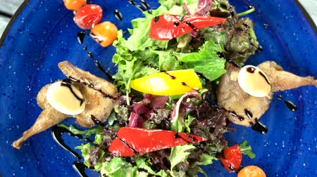 bird eggs : Salad top view. Roasted quail and vegetables.