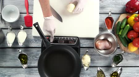 stamppot : Food preparation, electric cooker. Kitchen table, hands of chef.