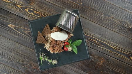 zabkása : Garnished barley porridge. Healthy food on wooden background.