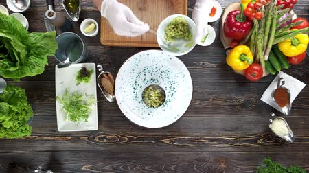 seafood recipe : Chef making herring tartare. Food ingredients on brown table.