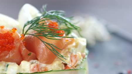 kaviár : Garnished olivier salad macro. Salmon and tobiko. Stock mozgókép