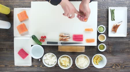 california rolls : Hands making sushi top view. Cooking table, japanese food. Stock Footage