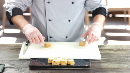 унаги : Sushi chef at cooking table. Unagi maki rolls. Стоковые видеозаписи