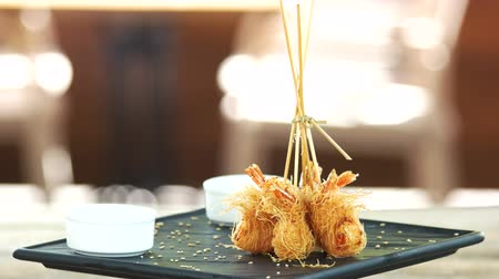 seafood dishes : Shrimp tempura on a plate. Seafood and kataifi dough. Stock Footage