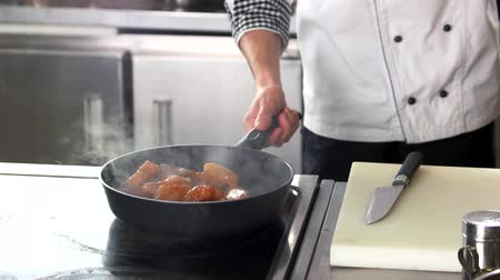 american cuisine : Chef frying chicken wings. Meat being cooked.