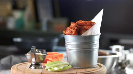сельдерей : Chicken wings, vegetables and sauce. Appetizer in a bucket.