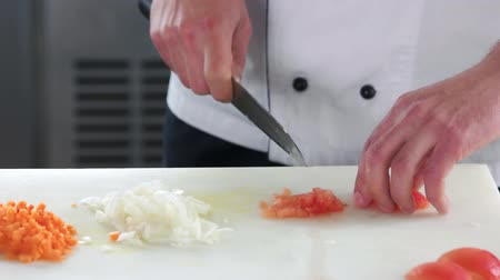 chef cooking : Hands chopping tomato. Man cutting vegetable close up. Stock Footage