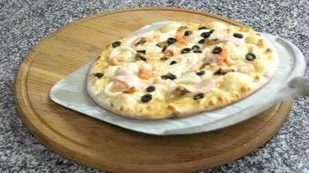 kalmar : Seafood pizza on wooden board. Delicious baked food.