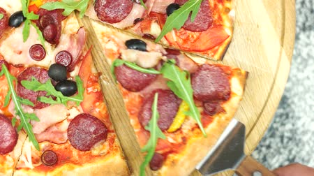 пепперони : Sliced pizza top view. Dough sausages and vegetables.