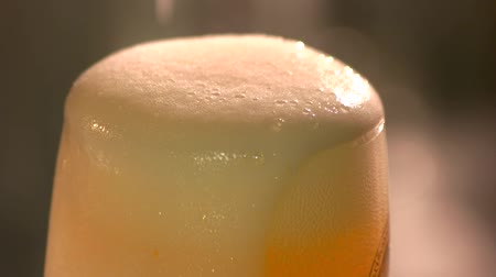 quartilho : Close up beer froth motion. Craft beer head with foam slow motion.