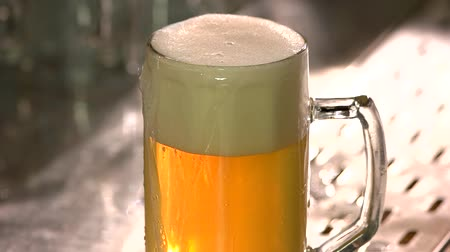 overfill : Foam beer skimmer cutting, close up. Stainless steel foam skimmer in action, slow motion.