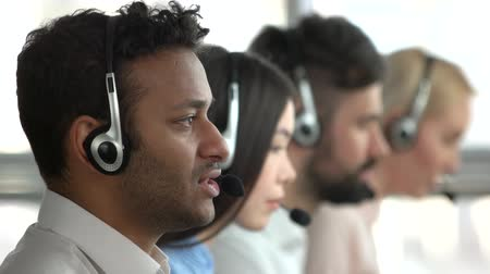 dispatcher : American black man working in tech support. Working indian operator face, side profile view.