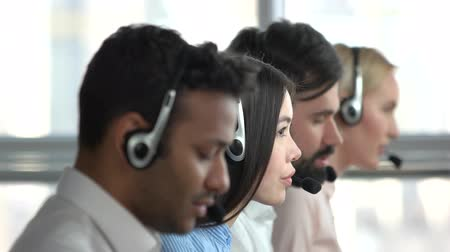 dispatcher : Young asian girl working in tech support. Young woman operator face, side view. Stock Footage