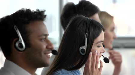 dispatcher : Female asian dispatcher working amoung collegues. Smiling asian young woman dispatcher working in office.