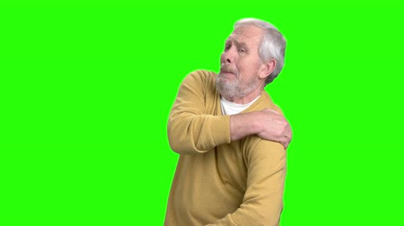 omuzlar : Elderly man having shoulder pain. Mature man suffering from arthritis, chroma key background.