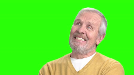 expectancy : Elderly dreaming man, green screen. Positive mature man on chroma key background. Human facial expressions. Stock Footage