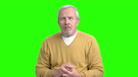 вырезка : Excited elderly man on green screen. Happy shocked elderly man clenched his fists, chroma key background. Expression of victory.