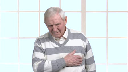 infarction : Elderly man with heart-attack. Old man having cardiac arrest. How to prevent heart-attack. Difference between cardiac arrest and heart attack.