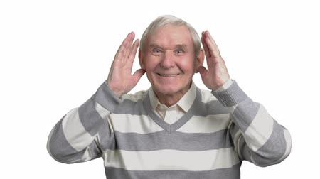 watching news : Cheerful pensioner watching football. Excited elderly man watching tv game and cheering, white background. Senior football fan.