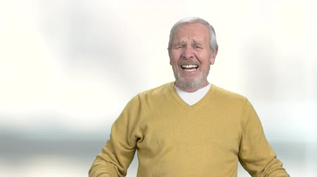 negative : Elderly man experiencing despair. Mature depressed man crying on blurred background. Human negative expressions.