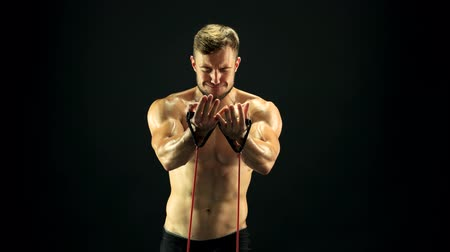 gumka : Athlete stretching resistance band. Strength developing with rubber band. Building strong muscles. Wideo