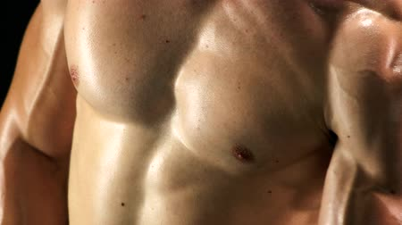 sports nutrition : Close up relief biceps of young sportsman. Muscular chest of sporty man. Bodybuilder training close up.