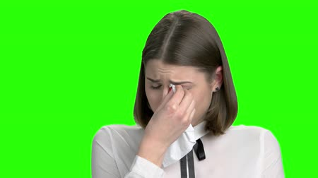 zsebkendő : Portrait of young crying girl. Sad woman weeping with handkerchief. Green screen hromakey background for keying.