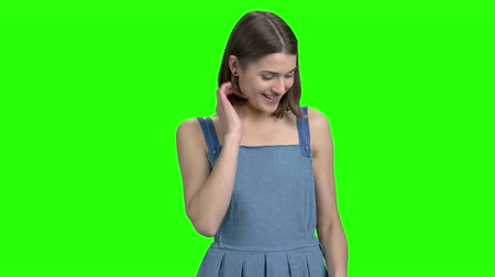 crossed : Young attractive girl wants to go on date with you. Beautiful girl flirting. Green screen hromakey background for keying.