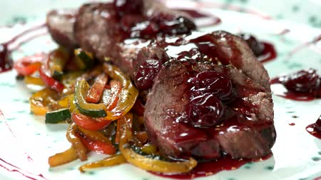 dana eti : Veal tenderloin with cherry sauce. Tasty meat dish close up. Stok Video