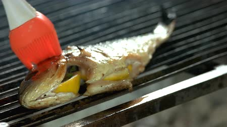 timo : Dorado on grill, basting brush. Stuffed fish preparation. Filmati Stock