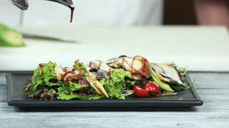 smoked : Salad with lettuce and eel. Delicious food on a plate.