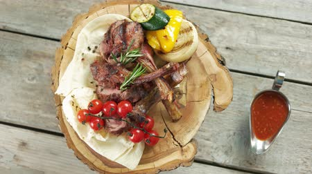 cielęcina : Barbecue veal with vegetables. Tasty dish and sauce.