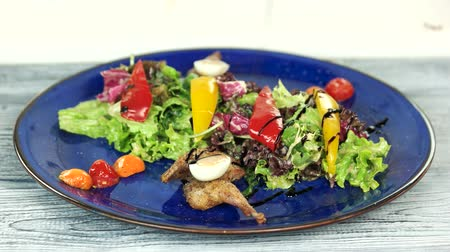 bird eggs : Tasty salad with sauce. Vegetables and roasted quail.