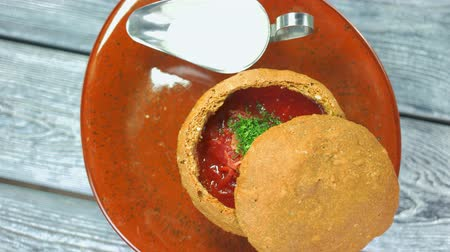 barszcz : Borsch with parsley top view. Vegetable soup and sour cream.