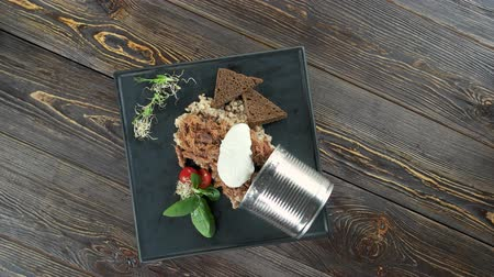 poached egg : Barley porridge with poached egg. Healthy dish on wooden background. Stock Footage