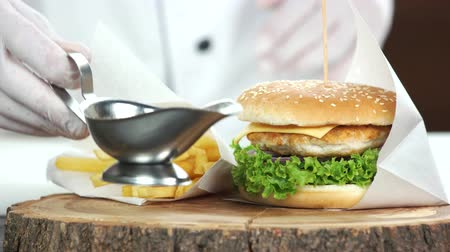 bread stick : Fast food meal, wooden board. Burger, fries and sauce. Stock Footage