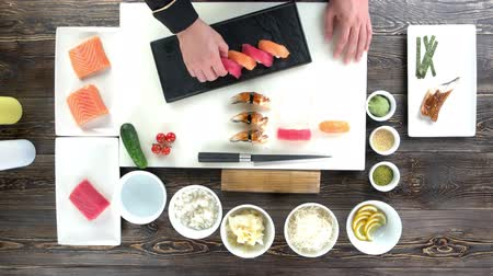 seafood recipe : Hands of chef, sushi. Cooking table, traditional japanese food.
