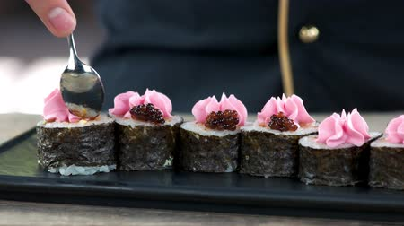 seafood recipe : Maki sushi with caviar. Traditional Japanese food close up.
