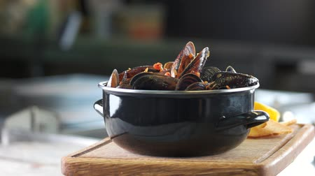 shellfish recipe : Mussels and fries, wooden board. Delicious restaurant meal.