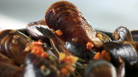 seafood recipe : Mussels with vegetables and rosemary. Steamed clams macro.