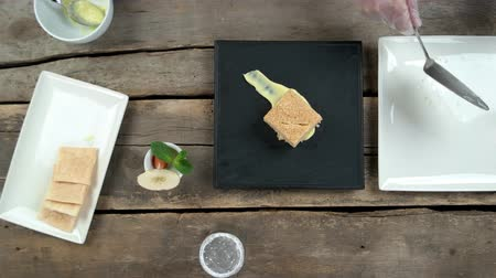 custard : Chef garnishing napoleon cake. Dried apple, mint and strawberry. Stock Footage